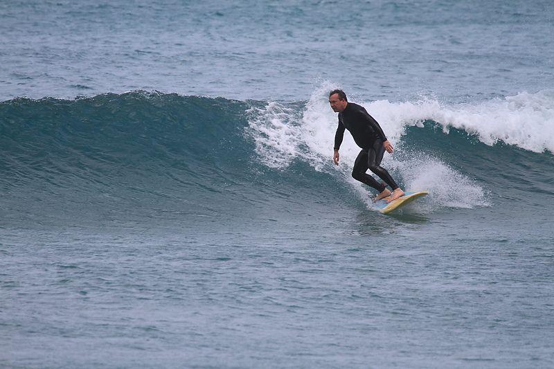 Alex surfing Lanza with gut